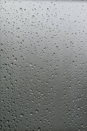 grey water: Background Water Droplets on Glass Vertical frame