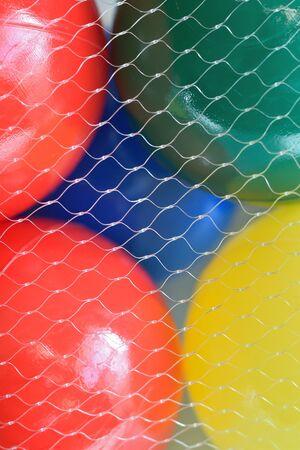macro: Macro colorful plastic balls in vertical frame Stock Photo