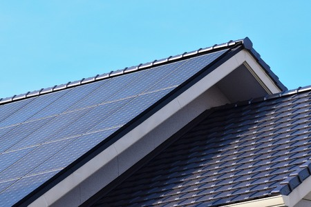 Solar panels fitted on modern house roof