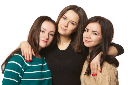 25 30 years old: three girlfriends on a white background isolation
