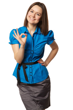 25 30 years old: cute girl in the blue shirt shows ok on white Stock Photo
