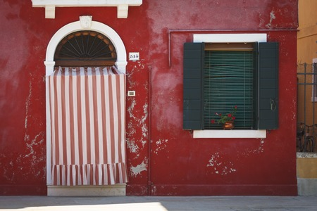 The Red House on the island of Burano, Italy photo