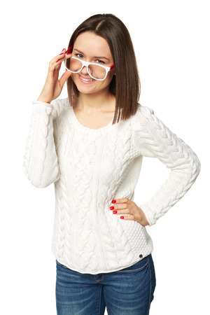 Portrait of young woman looking over glasses photo