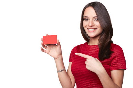 red hand: Young smiling beautiful sexy woman showing empty blank sign or gift card. Isolated on white