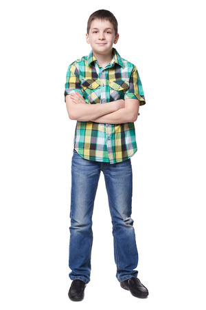 full lenght: Smiling young boy in shirt and jeans full lenght isolated on white Stock Photo