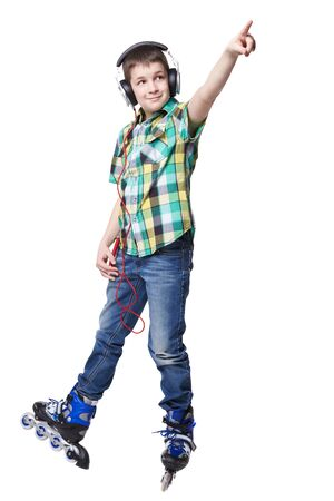 rollerblade: Full length portrait a boy on rollers pointing up sign isolated on white