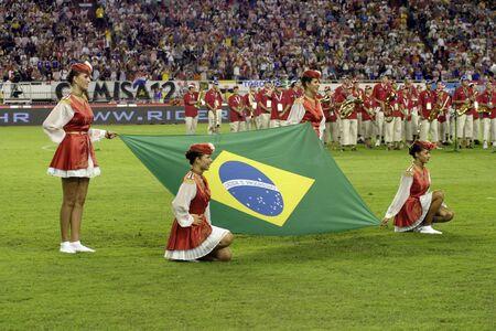 hymn: Split, Croatia - August 17, 2005 - Girls with brazilian flag while hymn playing  before the friendly game Croatia - Brazil