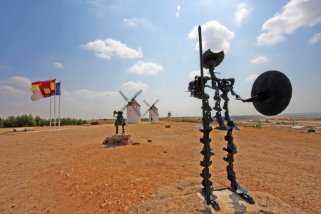 Don Quijote and Sancho Panza Statues in front of medival museum windmills on the Don Quijote route in Mota Del Cuervo, Spain photo
