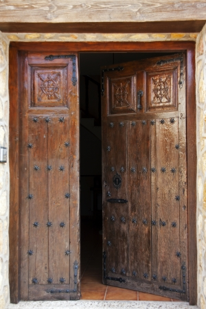 brilliantly: Brilliantly painted open wooden studded entrance doors