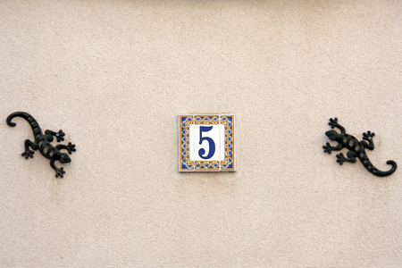 Ceramic House Street Number decorated with two geckos photo