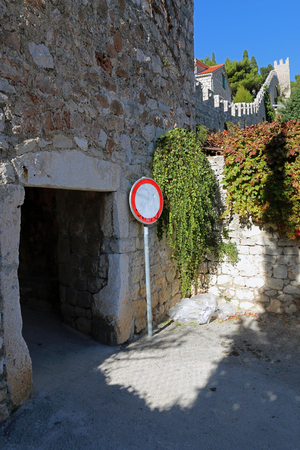 thee: Entrance through thee city walls of town of Hvar on the island of Hvar, CroatiaPhoto taken on: November 8th, 2015