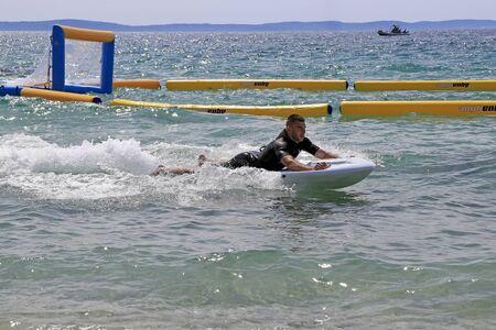 bodyboarder: Split, Croatia - 30 April, 2016: Presentation of the new electric jet surfing board kymera bodyboard in the water park