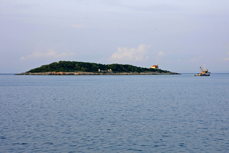 Islet of Host on the exit of Vis harbor