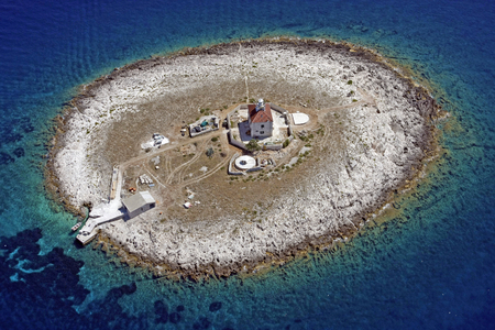 Pokonji Dol is the eastern-most islet of the Paklinski islands in the Adriatic Sea, Croatia, located 2 km south from Hvar. The lighthouse in the middle of the islet was built in 1872. Shot from air.