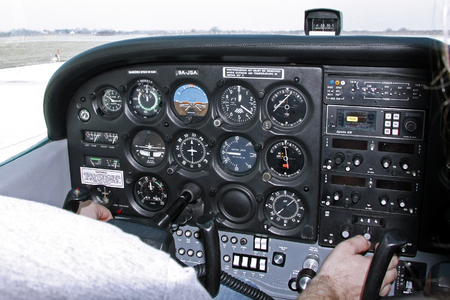 Zagreb, Croatia - February 25, 2012: Pilot cheks the instruments in the airplane before taking off