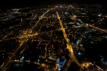 Night flight over the city lights, aerial night urban view of Zagreb streets taken from airplane