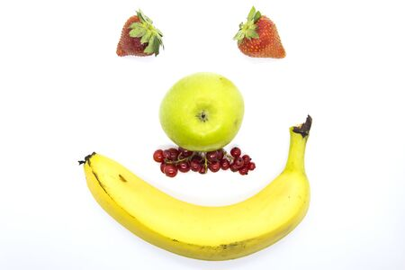 Smiling fruit face with currant mustache isolated on white background