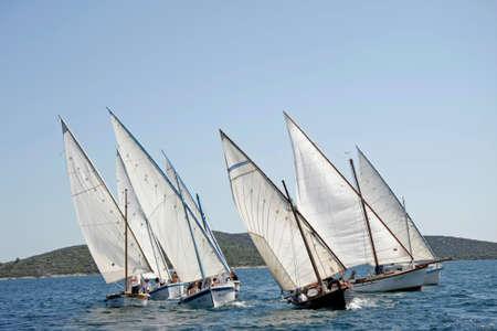 Murter, Croatia - 27 September, 2009: The crew prepares for the Latin Sail regatta while the dog waits on the shore