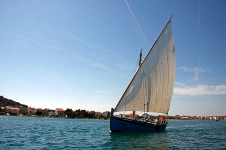 Betina, Croatia - 15 August, 2011: Traditional wooden sailboat during the regatta Latin Sail