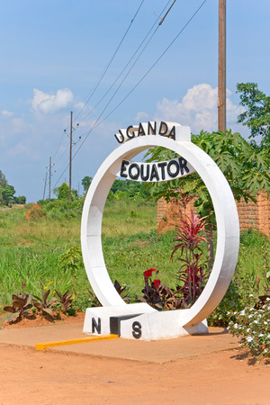 equator: Equator crossing sign monument in Uganda Stock Photo