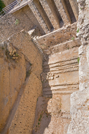 bethesda: Ancient stairway along brick wall in Pool of Bethesda ruins. Old City of Jerusalem, Israel. Stock Photo