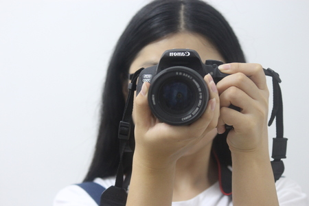 woman taking self photo with camera Editorial