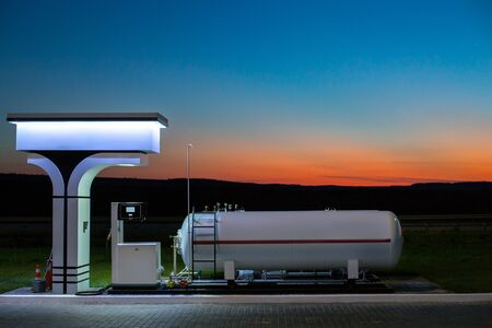 fuel tank: The modern, environmentally friendly and safe fueling at sunset Stock Photo