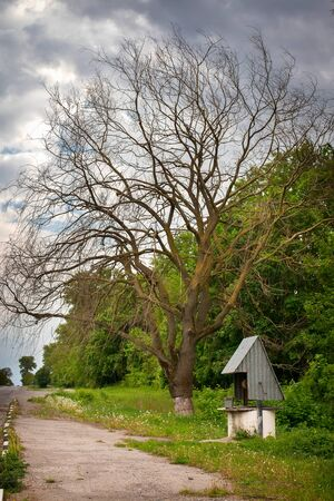 rural areas: Well standing by the road in rural areas of Ukraine