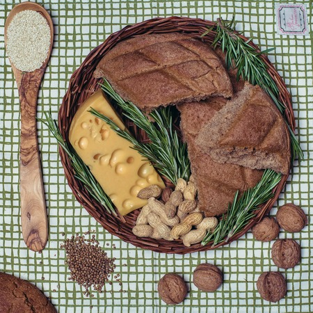 Gluten free bread on a kitchen towel from top view. Mixed homemade breads from amaranth flour. Healthy eating. Stock Photo