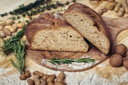 Gluten free bread on wooden background from top view. Mixed homemade breads from amaranth flour. Healthy eating.