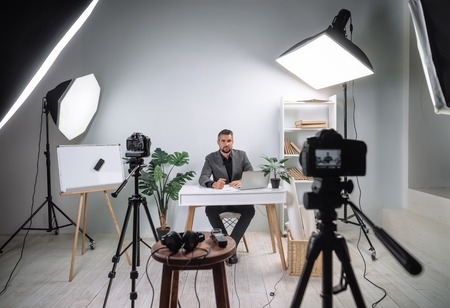 Video footage of the training program from a young business coach. Becxtage from recording a video of a businessperson's lecture. Record a TV program with a young handsome male presenter.