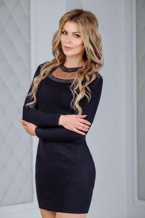 Sexy Woman In A Black Tight Dress Studio Interior Photo Beautiful