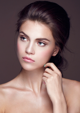by see: Glamour portrait of beautiful woman model with fresh daily makeup and romantic wavy hairstyle. Fashion shiny highlighter on skin, sexy gloss lips make-up and dark eyebrows Stock Photo