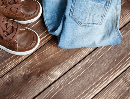 kinfolk: boots on brown Wood Background top view