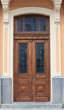Door with beautiful carved wood decorations  photo