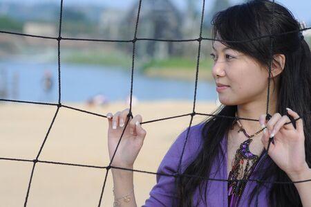 beautiful woman and volleyball net Stock Photo - 6096573