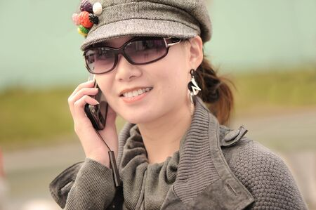 a beautiful woman is calling mobile phone Stock Photo - 6372008