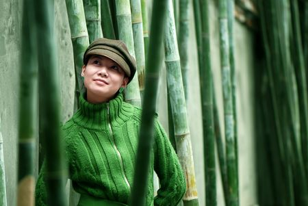 Woman in zhe bamboo forests Stock Photo - 6371974