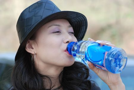 beautiful girl drink with a bottle Stock Photo - 6511326