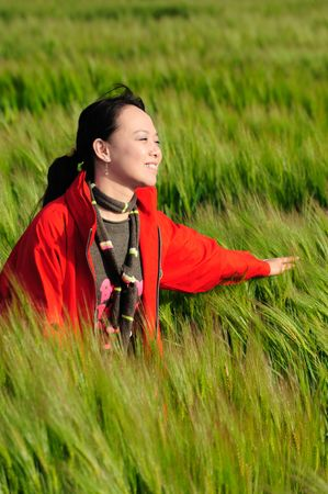 asian woman grass in red Stock Photo