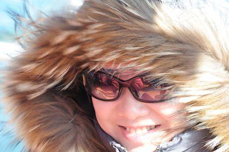 preety: preety girl with fur hat Stock Photo