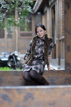 threshold: Woman sitting threshold Stock Photo