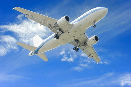 aeroplane on blue sky background Stock Photo