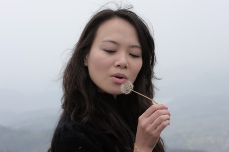 asian woman and dandelion photo
