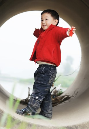 cuet little boy in Sewer Stock Photo
