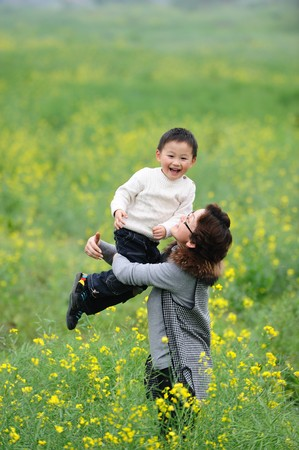 mother and son outdoor in flowers photo