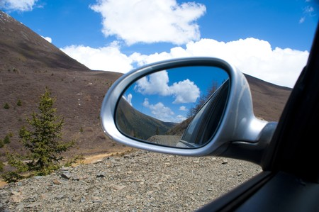 mirro: blue sky from Rearview mirro  Stock Photo