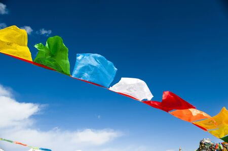 prayer background: prayer flags on blue sky background