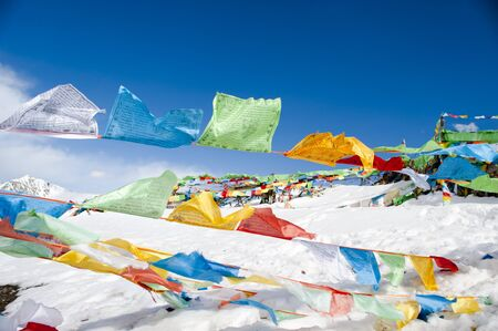 prayer flags on blue sky background photo