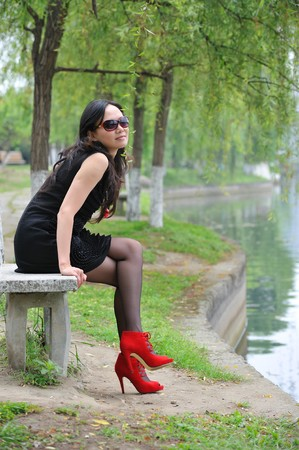 asian woman sit in Chair with  High-heeled shoes Stock Photo - 7282853